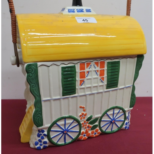 45 - Old Romany bone china biscuit barrel in the shape of a bow top gypsy caravan, with wicker bound hand...