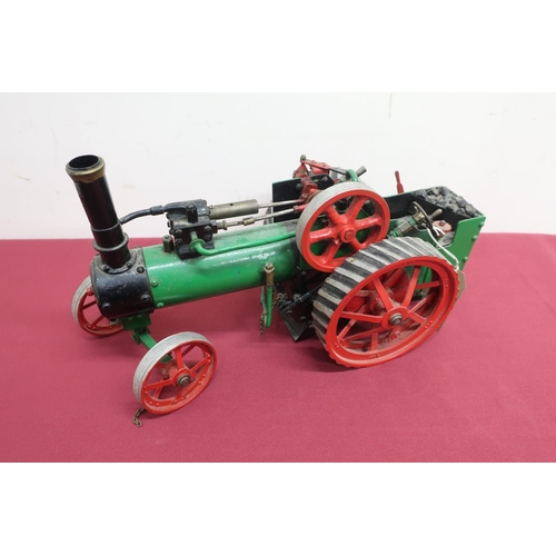 27 - Live steam model of a traction engine, probably scratch built, black and green body with red spoked ...
