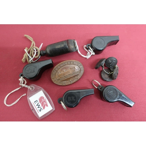 34 - Four Acme composition whistles, two stamped BR two IRS, a NER whistle, a LB & SCR Loco Dept cap badg...