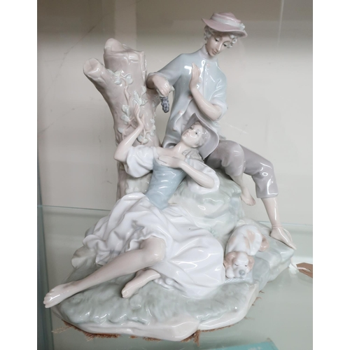 2 - Lladro porcelain group of lovers eating grapes, on naturalistic base with a dog (H27cm)...