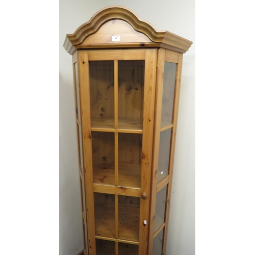 47 - Pine corner glazed display cabinet with four shelves above a drawer enclosed by a single door W75cm ...