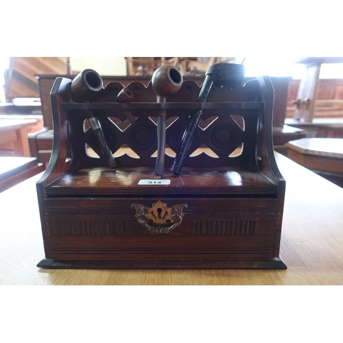 13 - Edwardian walnut pipe rack, raised back with single drawer with brass handle (H30cm x W23cm x D12cm)...