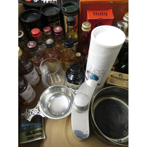 33 - Collection of whisky and spirit miniatures including: Bunnahabhain, Glenmorangie, Tullibardine and o...