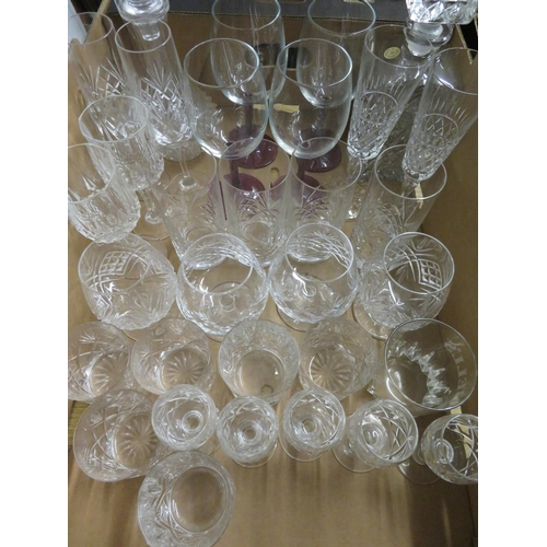 45 - Two lead crystal decanters, set of four wines with plum tint stems, four lead crystal brandy balloon...