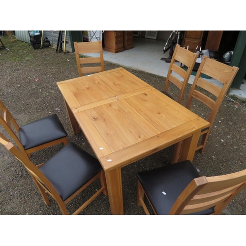 46 - Rectangular extending oak kitchen table on square supports L125cm x W89cm, and a set of six high lad...