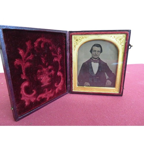 23 - Victorian Ambrotype photo. study of a gentleman, in arched mount, and leather case...