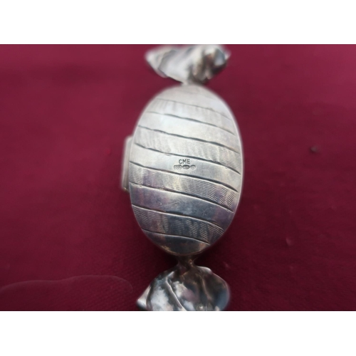 25 - Small box in the form of a wrapped boiled sweet, stamped CME 925, Geo. V engine turned silver curved...