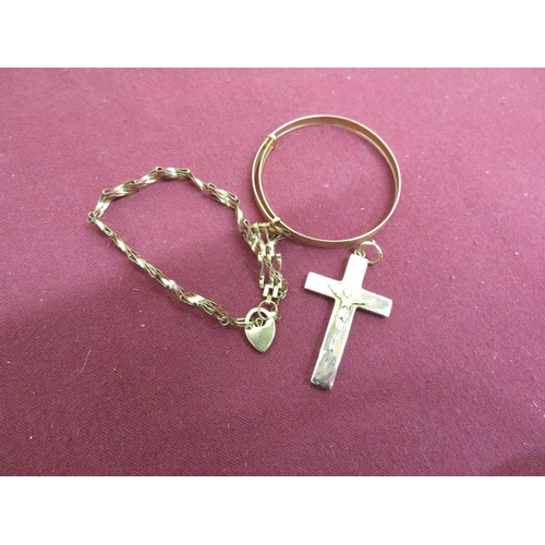 32 - 9ct hallmarked gold crucifix and gate bracelet, and another bracelet stamped 375, 6.5g (3)...