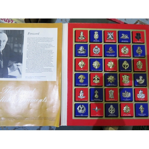 58 - Commemorative folder of mounted Great British Regiments badges...