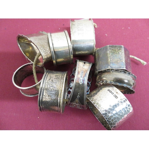 25 - Collection of nine Victorian and later hallmarked silver napkin rings, variously decorated, Birmingh...