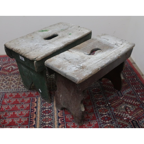 409 - Two rustic stools, rectangular tops pierced with hand grip, W48cm x H35cm x D27cm max. (2)...