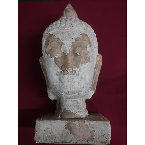 427 - Pottery model of a Tibetan deity head, with remnants of white finish, on a rectangular base, H43cm...