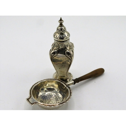 490 - Geo. V Art Nouveau design silver pepperette Birmingham 1913, a Geo. V silver tea strainer with turne...