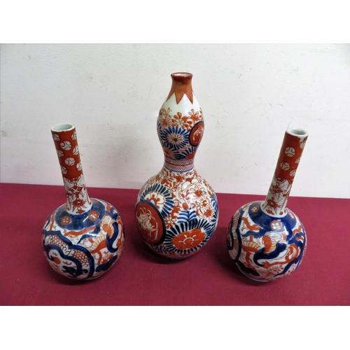 492 - A pair of Japanese Imari pattern mallet shaped vases (H18cm), similar double gourd shaped vase. (H22...