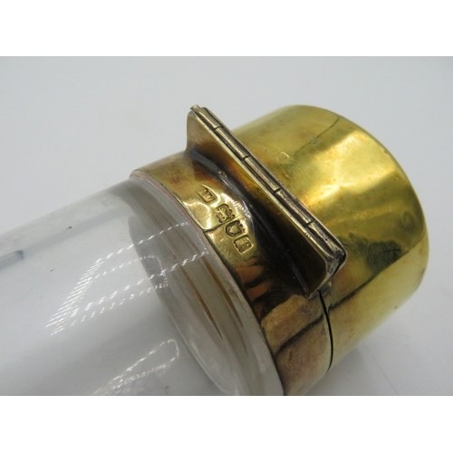 494 - Large Edw. VII clear glass cylindrical scent bottle, silver gilt hinged lid and collar hallmarked Lo...