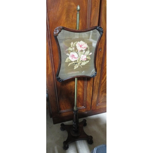 439 - William IV rosewood pole screen with shaped wool work banner on brass column, the shaped base on lob...