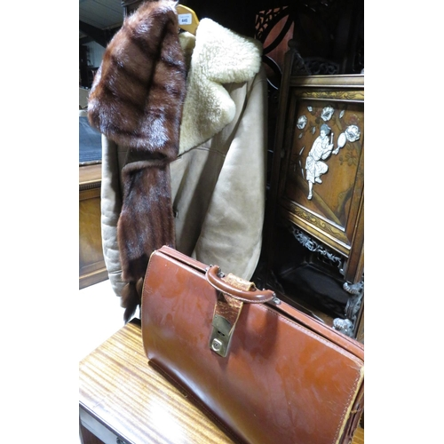 446 - Nurseys Gents sheepskin coat, a mink stole and a gents brown leather briefcase (3)...