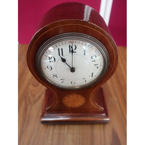 461 - Edwardian inlaid mahogany balloon shaped mantel time piece with white Arabic dial on four brass ball...