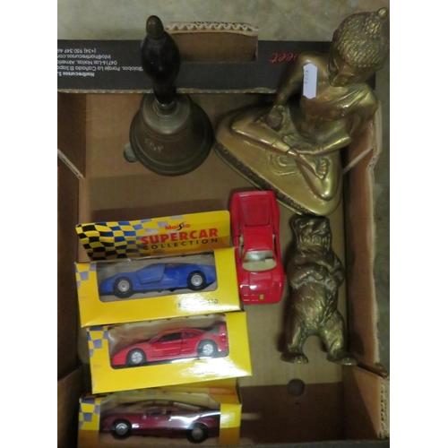 468 - Cast brass figure of seated Buddha, brass hand bell with turned ebony handle, cast brass money box i...