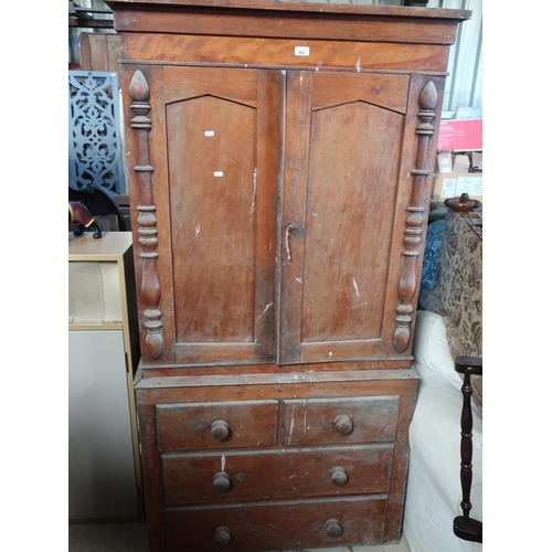 462 - Victorian pine cupboard on chest with stepped cornice above a pair of doors enclosing fitted shelves...