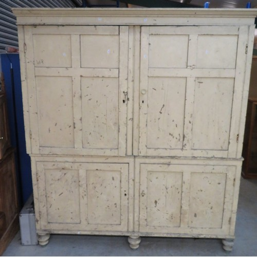 410 - Large Victorian pine housekeepers cupboard with moulded cornice enclosed by four four panelled doors...