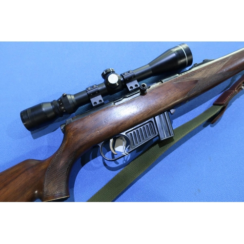 328 - Voere .22 LR semi auto rifle, fitted with sound moderator and 3-9x40 scope, complete with rifle slin...