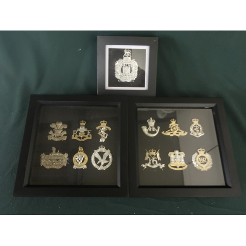 147 - Three small framed and mounted displays of British military cap badges, various regiments including ...