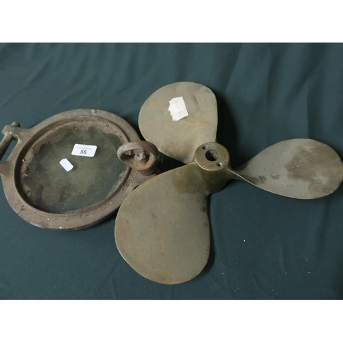 56 - Marine brass propeller and a port hole with glass (D22cm) believed to be from HMS Sincere...