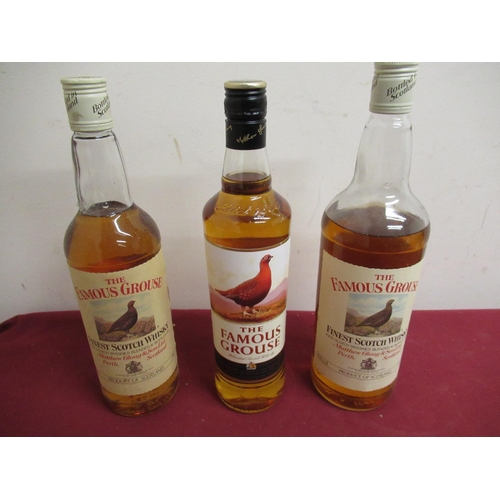 145 - The Famous Grouse Finest Scotch Whisky 1ltr 43%vol, (low level), two similar 75cl & 70cl both 40%vol...