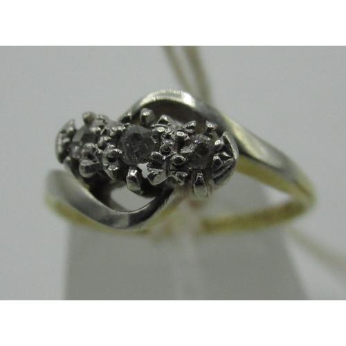 132 - 18ct and fine plat. three-stone diamond crossover ring...