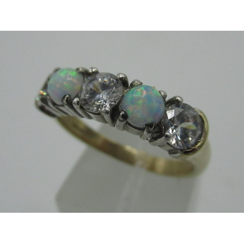 133 - 9ct gold hallmarked white stone and opal ring, boxed...