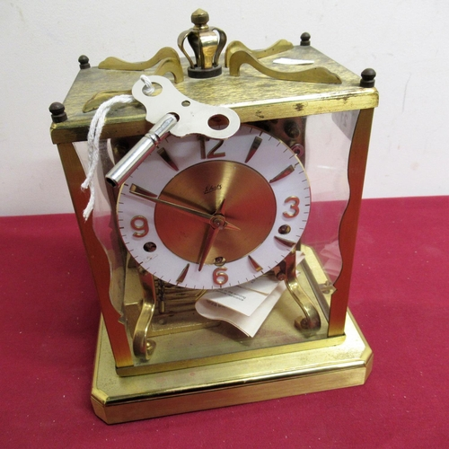 21 - Mid 20th C Schatz mantel clock, lacquered brass case  with four glazed panels on platform base, thre...