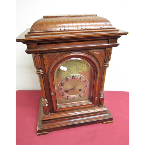 26 - Early 20th C mahogany cased mantel clock, architectural case with engraved arched brass dial and sil...