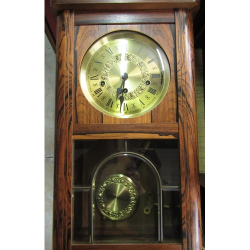 39 - Late 20th C German wall in clock simulated rosewood case, single glazed leaded panel door enclosing ...