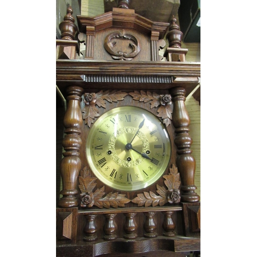 40 - Late 20th C wall clock, in carved oak case with turned finials and gallery, single glazed door enclo...