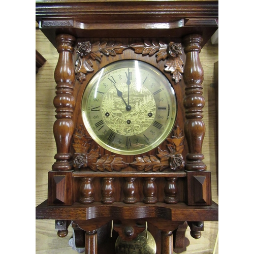 42 - Late 20th C German wall clock in carved oak case with turned finials and gallery, single glazed door...