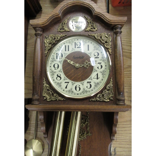 43 - Late 20th C Eurobell wall clock, oak case with carved and half turned pillars and applied bass spand...