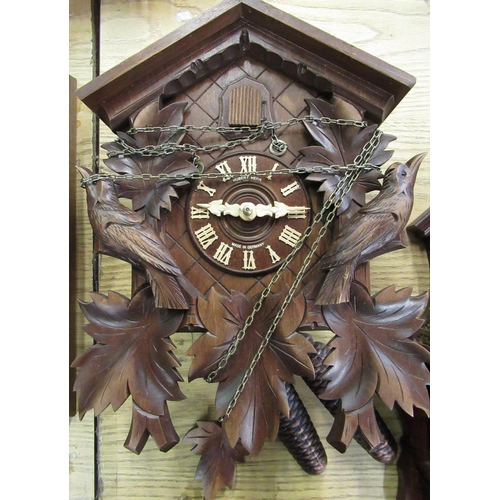 44 - Late 20th C Hubert Herr Black Forest cuckoo clock, caved and stained case with two train weight driv...