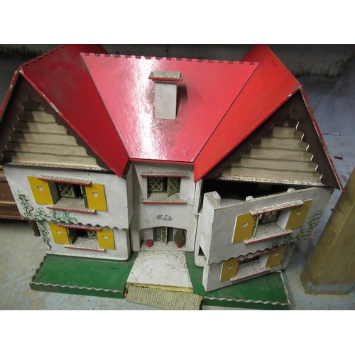 121 - Double fronted dolls house with two opening bays containing a small quantity of wooden and other fur...