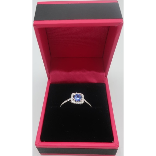354 - Hallmarked 18ct white gold sapphire and diamond ring of approx 85 points...
