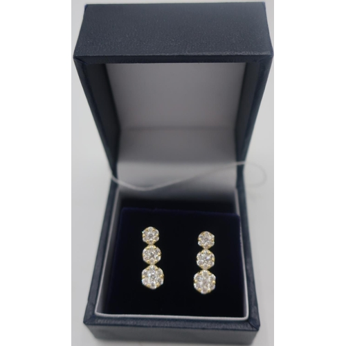 359 - Pair of stamped 18ct yellow gold diamond cluster earrings of approx 1.2cts...
