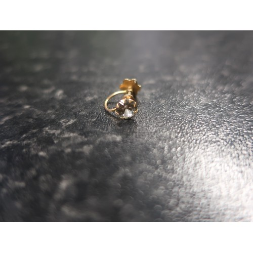 134 - Pair of single stone gold white stone ear studs stamped 375 and a similar single clip type earring, ...