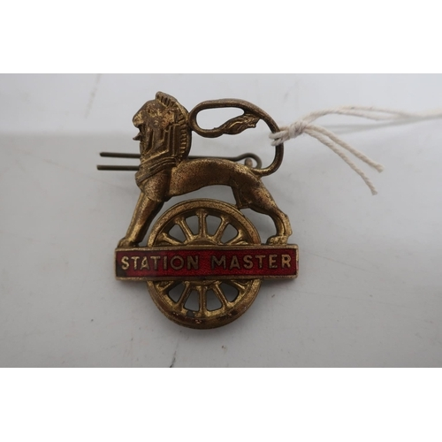 175 - BR brass and red enamel Station Master cap badge...