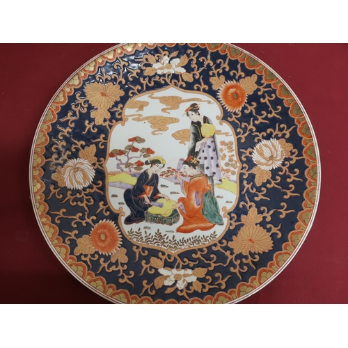 1 - Large Japanese circular charger, the centre decorated with females in a landscape in a blue ground c...
