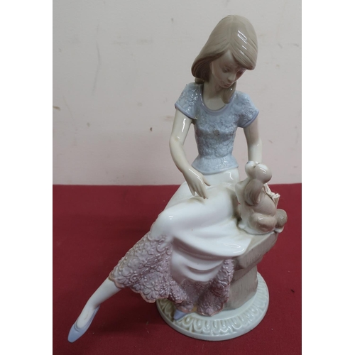 12 - Lladro porcelain figure of a girl seated with a puppy and a parasol, No 7612, and two similar Lladro...