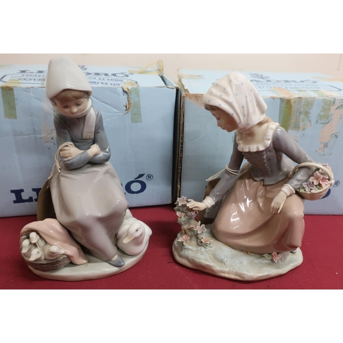 13 - Lladro porcelain figure of a seated girl and duck No 1.267, a similar model of a girl with a flower ...