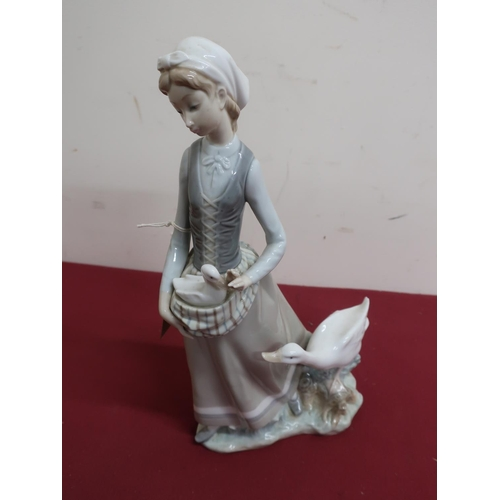 16 - Lladro porcelain figure of a girl with duck and duckling