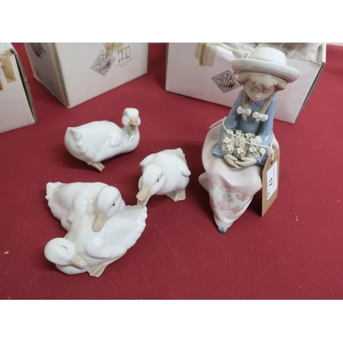 17 - Lladro model of a girl seated with a posy of flowers, in Nao box, and three Nao figures No 368, 369 ...