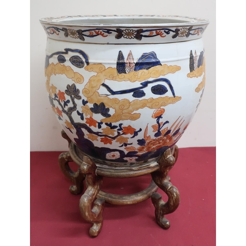 5 - Japanese fishbowl, the exterior decorated in Imari pallette with trailing foliage, the interior with...