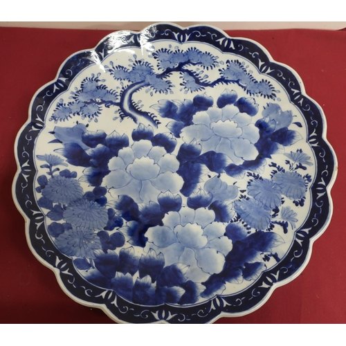 6 - Japanese waved edge circular blue and white charger, all over decorated with chrysanthemums, prunus ...